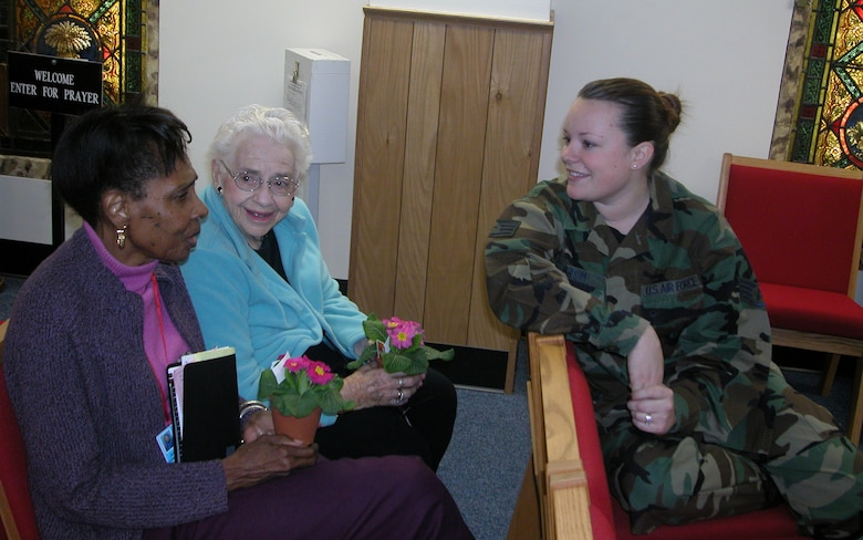 Staff Sgt. Claire Brom, 459th Financial Management, chats with a couple of veterans at the 459th Air Refueling Wing's Valentine's visit to the Armed Forces Retirement Home in Washington.  Sergeant Brom and several other members of the Air Force Reserve Command unit delivered warmth, laughter, cheer and goodies to the men and women of the AFRH.  The wing gave the veterans flowers, gifts and other goodies. The wing has adopted the AFRH as part of its family.