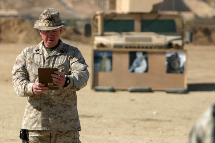 Charlie Company 1st Sgt. Michael Wooten conducts roll call during a memorial service held in honor of Cpl. Orville Gerena, Lance Cpl. David Parr, and PFC Jacob Spann at Al Asad Air Base, Iraq Feb. 18, 2006.  The three Charlie Company Marines were killed conducting counterinsurgency operations in Iraq's Al Anbar province.