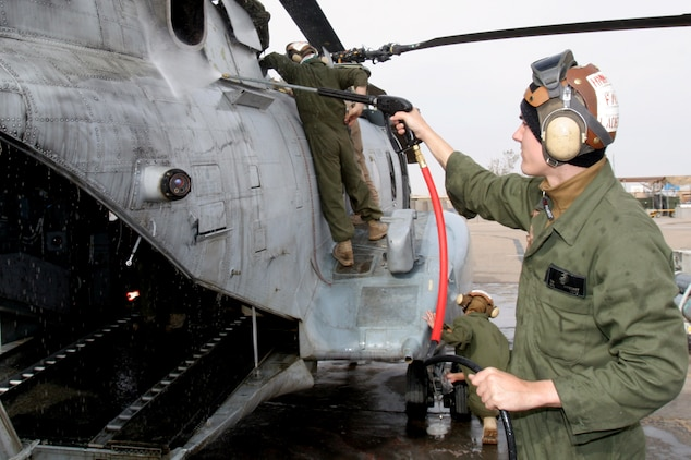 Cpl. Travis N. Ladegast sprays down a CH-46 Sea Knight helicopter Feb. 21 at Al Taqaddum, Iraq. Ladegast is a flight line mechanic and Rockford, Mich., native with Marine Medium Helicopter Squadron 268, Marine Aircraft Group 16, 3rd Marine Aircraft Wing. The Red Dragons received responsibility for casualty evacuation and general aviation support missions from HMM-161, MAG-16, 3rd MAW, Feb. 25.
