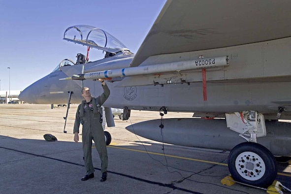 EGLIN AIR FORCE BASE, Fla.  — Lt. Col. Glenn Graham, 40th Flight Test Squadron commander, inspects the P5 Combat Training System before taking it out on a flight test.  (Photo courtesy of Cubic Corporation)
