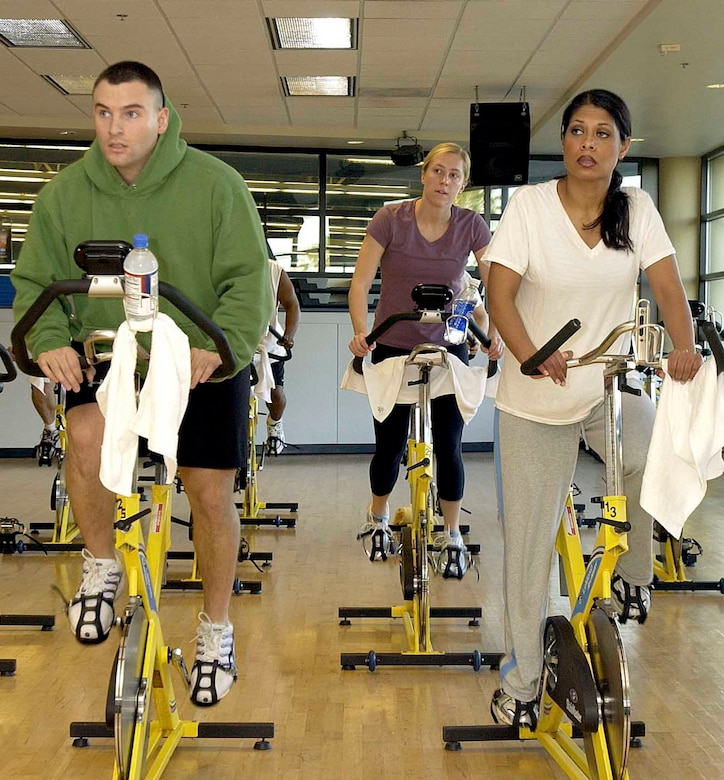 Anthony Sibilia and his wife, Marisa Sibilia, work out together during the Valentine's Day Aerobathon Monday. Being physically active for 30 to 60 minutes a day can help people lower their blood pressure, reduce cholesterol levels and maintain a healthy weight. (U.S. Air Force photo by Andre Mansour)