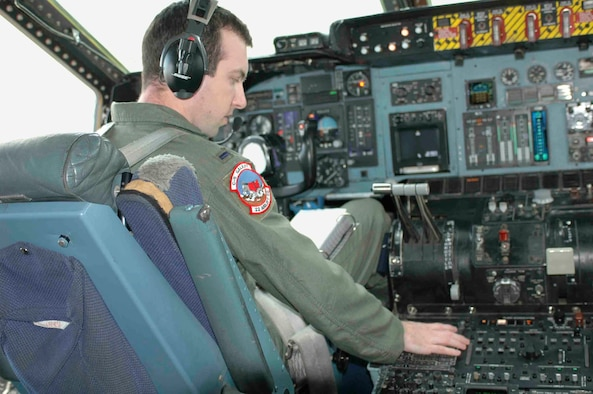 1st Lt. Bryan Foley, 22nd Airlift Squadron pilot, sets up his navigational aids and radios prior to taxiing out during his checkride Feb. 3. Lieutenant Foley was the last active-duty C-5 co-pilot to upgrade. Travis is one of two active C-5 bases; the other is Dover Air Force Base, Del. (U.S. Air Force photo by Airman 1st Class Tiffany Low)