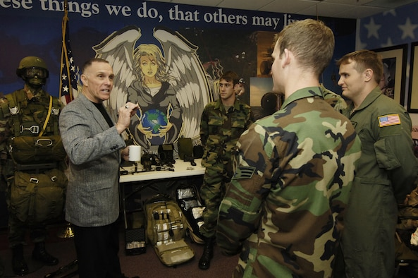 MOODY AIR FORCE BASE, Ga. - Retired Chief Master Sgt. Wayne Fisk speaks with several 38th Rescue Squadron pararescuemen during his visit to Moody recently. Chief Fisk joined the Air Force as a pararescueman in 1966. (Photo by Staff Sgt. Manuel Martinez)