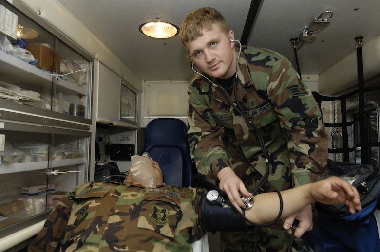 MOODY AIR FORCE BASE, Ga. - Staff Sgt. Jason Boutwell, 347th Aeromedical Dental Squadron, practices checking a patient's blood pressure on Staff Sgt. Ethan Hawkins, 347th ADS, Jan. 31. Sergeant Boutwell plans to transition from blue to green so he can become an Army warrant officer and helicopter pilot. (Photo by Staff Sgt. Manuel Martinez)