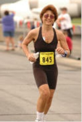 Senior Airman Christina Lindstrom dashes for the finish line during a 2005 marathon race.  Airman Lindstrom pursued her personal goal, losing nearly 50 pounds, in order to reenter the Air Force Reserve.