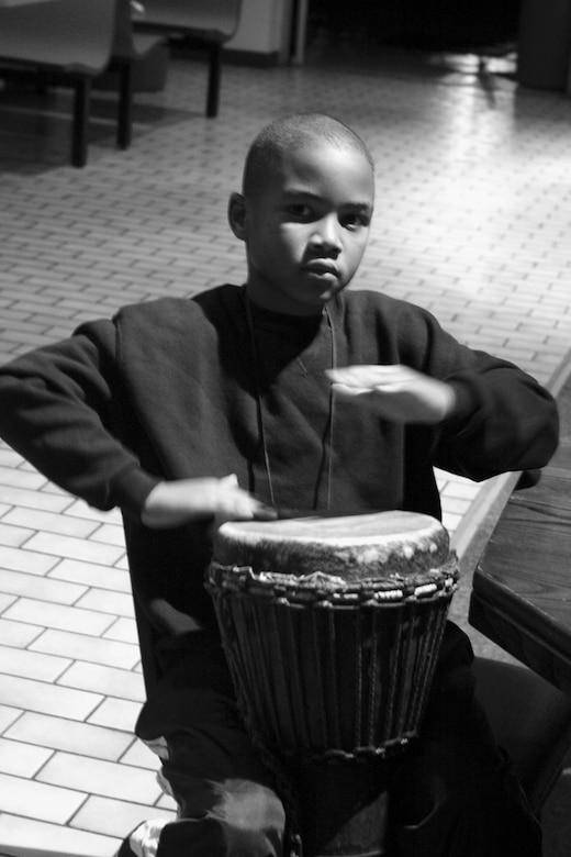 A child plays the drums during the African American heritage Airmen's Night Out in the community center Wednesday.