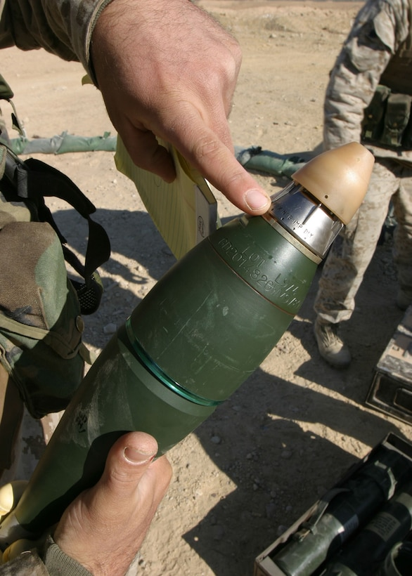 Corporal Michael A. Kelly, of Jacksonville, Fla., a squad leader, points to a delay setting on an 81mm mortar round, Jan. 1, 2006.  Kelly is a member of the 81mm mortar platoon of Battalion Landing Team 1st Bn., 2nd Marines, the ground combat element of the 22nd Marine Expeditionary Unit (Special Operations Capable), which is in Iraq's Al Anbar province conducting counterinsurgency operations with the 2nd Marine Division.