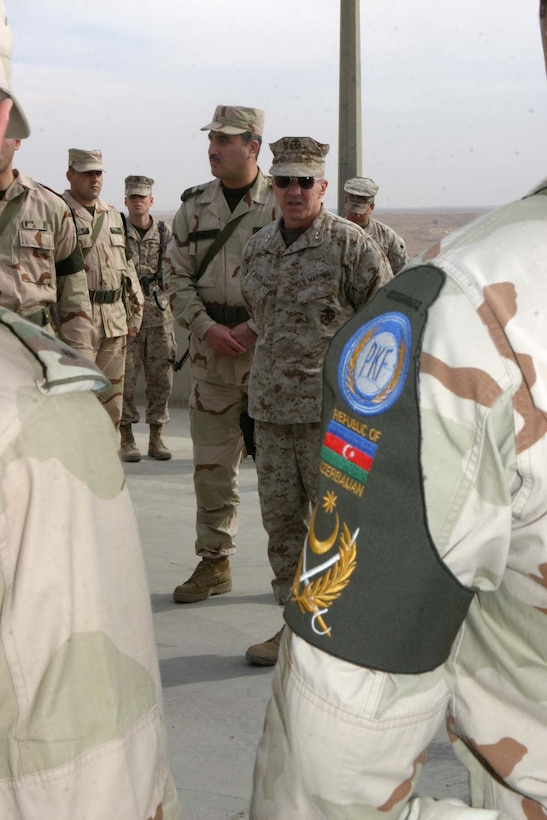 HADITHA DAM, Iraq (Jan. 2, 2006) - Major Gen. Richard A. Huck, the commanding general for 2nd Marine Division, talks to Azerbaijani troops during a visit here Jan. 2. Huck met with the troops to congratulate them on a job well done while supporting 2nd Marine Division in Operation Iraqi Freedom. (Official Marine Corps photo by Cpl. Adam C. Schnell)