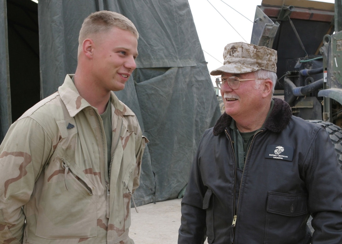 Corporal Stephen M. Koren, of Belleville, Mich., a motor transport mechanic with MEU Service Support Group 22, talks with Col. Harvey C. Barnum Jr. (USMC, Ret.) during his visit to Forward Operating Base Hit, Iraq, Jan. 5, 2006.  Colonel. Barnum, who was awarded the Medal of Honor for heroism in Vietnam and is now the Assistant Secretary of the Navy (Reserve Affairs), accompanied the Assistant Commandant of the Marine Corps, Gen. Robert Magus, on a visit to the 22nd Marine Expeditionary Unit (Special Operations Capable) as it conducts counterinsurgency operations with the Second Marine Division in Iraq's Al Anbar province.