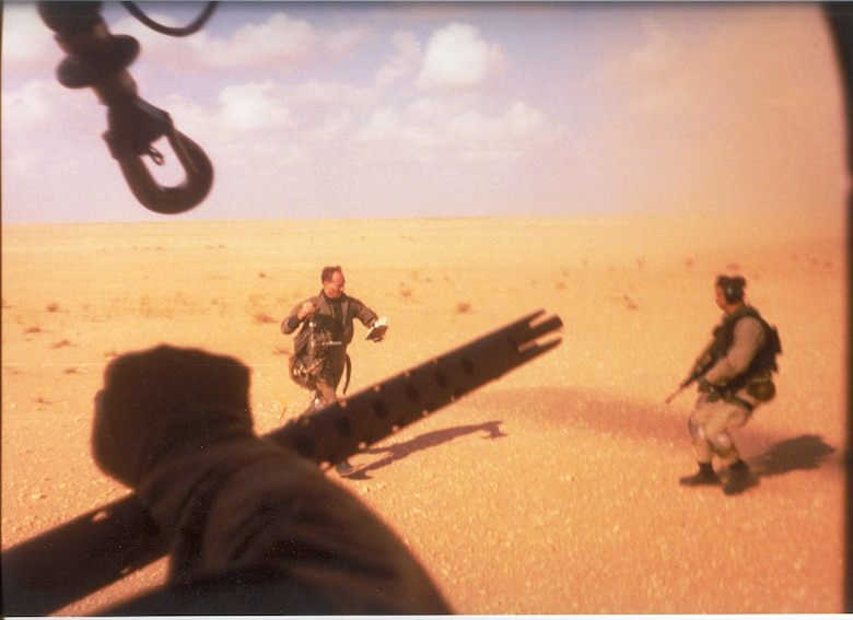 Navy Lt. Devon Jones, left, runs towards the PAVE LOW that rescued him during Operation Desert Storm. The 20th SOS conducted the first combat search and rescue since the Vietnam War.