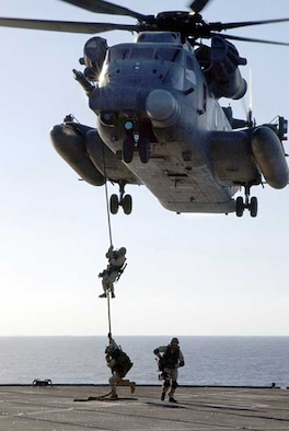 030117-N-0000K-001At sea aboard USS Mount Whitney (LCC/JCC 20) Jan. 17, 2003 -- A U.S. Navy SEAL (SEa, Air, and Land) fast-ropes from an MH-53 RPave LowS helicopter during a Maritime Interception Operation (MIO) training exercise.  U.S. Navy SEALs are deployed throughout the world conducting missions in support of Operation Enduring Freedom.  U.S. Navy photo by Petty Officer 2nd Class George R. Kusner.  (RELEASED)