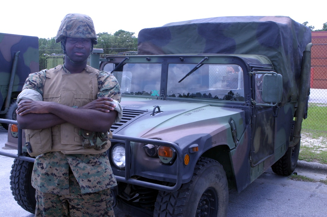 Pfc. J. L. Evans, a motor vehicle operator with 5th Battalion, 10th Marine Regiment, stands next to the 5,500 lb. M1123 hummer. Evans and other ?Motor T? Marines operate these vehicles during patrols and traveling from one place to another quickly while deployed to Iraq.