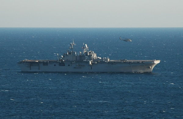 A helicopter assigned to the Desert Hawks of Helicopter Sea Combat Squadron Two Six (HSC-26), practice flight deck landings aboard the amphibious assault ship USS Iwo Jima (LHD 7). Iwo Jima is currently underway conducting routine exercises.