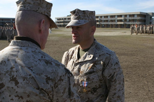 MARINE CORPS BASE CAMP LEJEUNE, N.C. -- Lt. Col. Todd S. Desgrosseilliers was awarded a Silver Star Medal here Feb. 10 by Brig. Gen. Joseph J. McMenamin.  He led Task Force Bruno in Fallujah, Iraq eliminating insurgent footholds in the city.  Photo by 1st Lt. Barry Edwards.