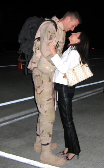 MOODY AIR FORCE BASE, Ga. - Airman 1st Class Jason Smith, 41st Helicopter Maintenance Unit, is greeted by Amy Pierce shortly after home from Balad Air Base, Iraq, Saturday. Approximately 25 Airmen from the 41st HMU and 41st Rescue Squadron arrived via a C-5 Galaxy after more than two months at Balad. (U.S. Air Force Photo by Senior Airman Shannon Fielder)