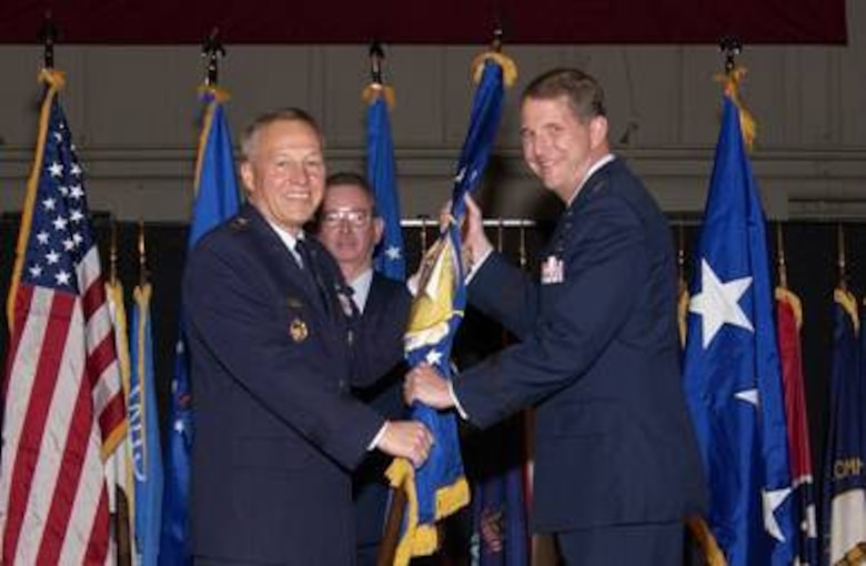 Gen. Bruce Carlson, commander, Air Force Materiel Command, passes the flag to Maj. Gen. Ted Bowlds, during the Air Force Research Laboratory Appointment of Command ceremony Jan. 9 at the National Museum of the U.S. Air Force, Dayton, Ohio.    (Air Force photo by Marvin Baumgarter)