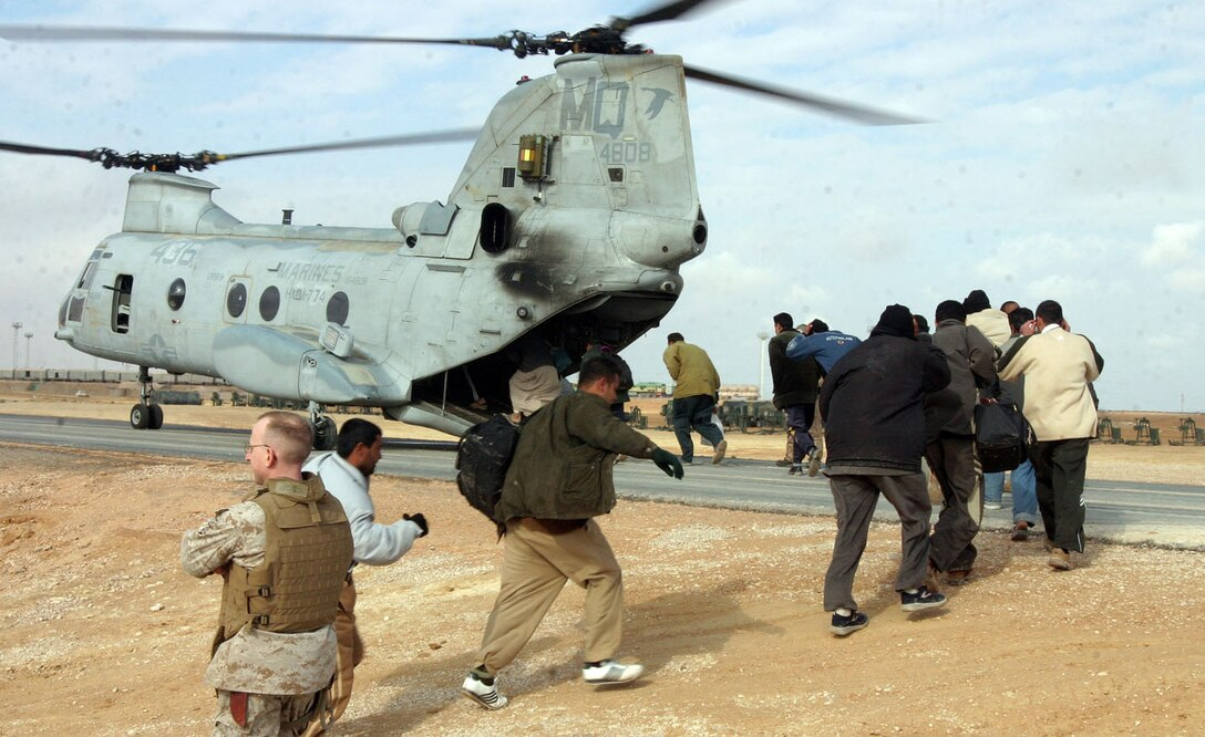 CAMP AL QA'IM, Iraq (Jan. 12, 2006) -- Iraqi police recruits board a CH-46 Sea Knight.  The recruits were on there way to Bagdhad to attend the Iraqi Police Academy and will return to serve as policemen in the Al Qa'im region.  (Official U.S. Marine Corps photo by Sgt. Jerad W. Alexander)