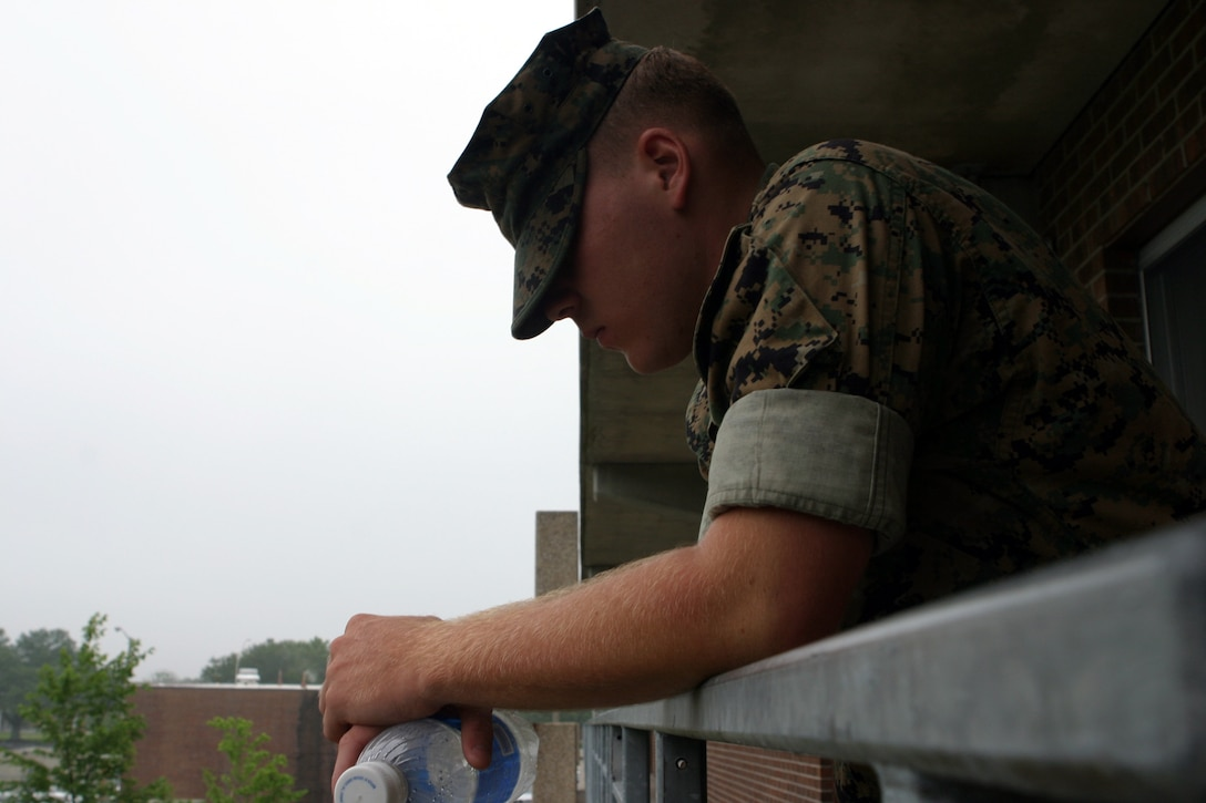 MARINE CORPS BASE CAMP LEJEUNE, N.C.- Pfc. Brian Smith, a logistics clerk with Headquarters Battalion, 2nd Marine Division, takes a few moments to contemplate his day. Smith spends an average of forty dollars a day paying off his family?s debt.