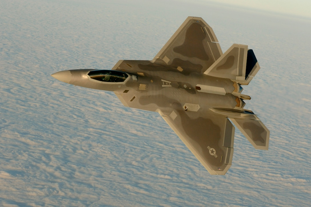 OVER THE ATLANTIC OCEAN (AFPN) -- Capt. Chris Batterton aggressively banks his F-22A Raptor during a basic fighting maneuver training mission off the Virginia coast last week. The captain is with the 27th Fighter Squadron, the Air Force's first unit to fly the Raptor. The 1st Fighter Wing declared initial operational capability last month, making the Air Force's fifth generation fighter ready to fight. (U. S. Air Force Photo by TSgt Ben Bloker)