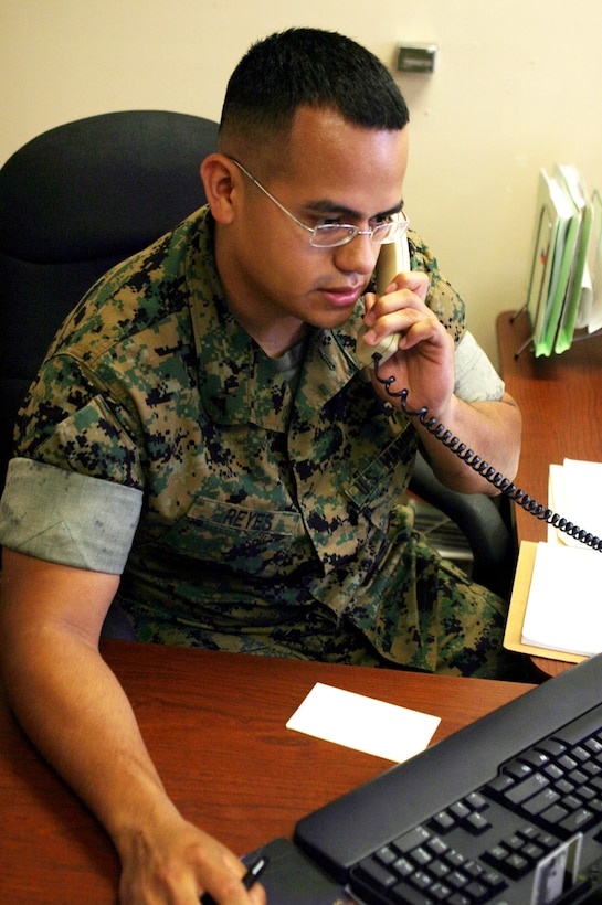 MARINE CORPS BASE CAMP LEJEUNE, N.C. (August 15, 2006)- Lance Cpl. Dorian Reyes, a legal clerk with the Staff Judge Advocate's office for the 2nd Marine Division answers a phone call while at work. Reyes, like many high school students, participated in the Junior Reserve Officers Training Corps while in high school and received a promotion to for his efforts. To get a promotion from any branch of service, future recruits must have successfully completed at least two years in J.R.O.T.C.
