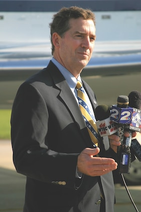 United States Senator Jim DeMint (R-SC), the Chairman of the Senate Subcommittee on Disaster Prevention and Prediction, addresses reporters on the Air Station flight line Aug. 17. The senator was visiting the Air Station to host a Hurricane Preparedness Hearing with  Air Station and local officials.