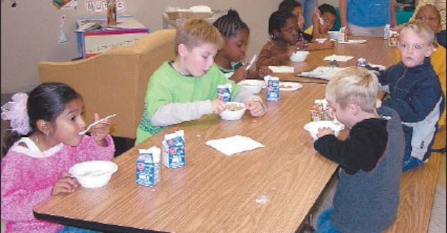 Tuesday, children enjoy a snack in the new youth center multi-purpose room. The newly opened addition offers equipment and space to keep children active.