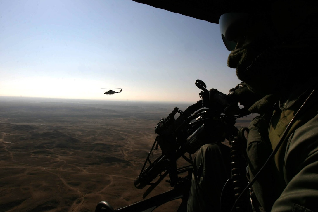 An AH-1W Super Cobra with Marine Medium Helicopter Squadron 261 (Reinforced) stays close to his wingman, a UH-1N Huey also from HMM-261 (Rein.) during a recent mission near Hit, Iraq.  The squadron is the aviation combat element for the 22nd Marine Expeditionary Unit SOC (Special Operations Capable) which is conducting counterinsurgency operations with the 2nd Marine Division in Iraq?s Al Anbar province.