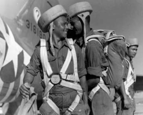 Three Nepalese Gurkhas prepare to board an air commando C-47 bound for Burma. The question mark on the tails of the C-47s came from all the questions air commandos got about the unusual equipment attached to them for snatching gliders.