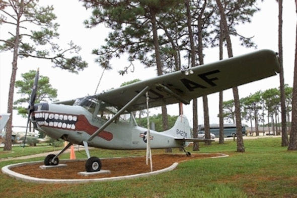 "In 1950 Cessna won an Army design competition for a light, two-seat liaison and observation aircraft. They mated the wings and tail of one aircraft to a new fuselage with a large windowed ""glasshouse"" cabin and a 213 horsepower engine. The Army bought this L-19 Bird Dog which served in the Korean and Vietnam Wars."
