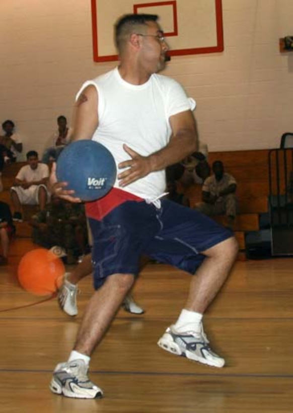 MARINE CORPS BASE CAMP LEJEUNE, N.C., (July 19, 2006) - Lance Cpl. Ish Barrera, a division personnel administrative center personnel clerk fires a ball at the enemy forces.  The Marines played dodgeball July 19, at the French Creek Fitness Center.  Official Marine Corps photo by Pfc. Joseph D. Day