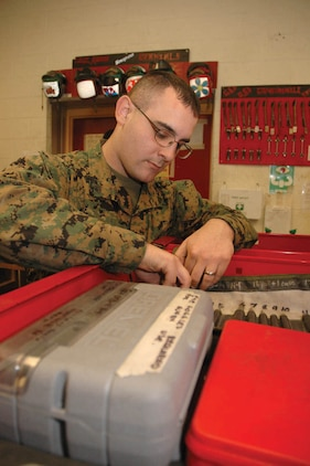 Cpl. Brandon J. Gallagher, Marine Attack Squadron 311 tool room noncommissioned officer-in-charge and native of Livermore, Calif., unrolls a case of float punches to count them at the end of his shift Jan. 19 in the VMA-311 hangar. If a tool is unaccounted for, all flights stop as proper administrative action is taken and a foreign objects and debris walk is conducted to find the missing tool.