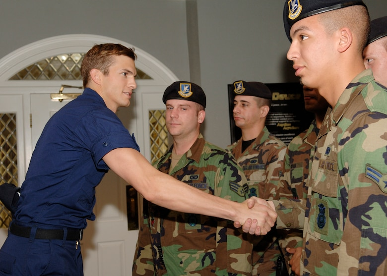 "BARKSDALE AIR FORCE BASE, La. (AFPN) -- Ashton Kutcher greets 2nd Security Forces Squadron Airmen. The Airmen provided security support on the set of ""The Guardian"" while it filmed on base Jan. 12 and 13. (U.S. Air Force photo by Airman 1st Class Kendra Fulton)"