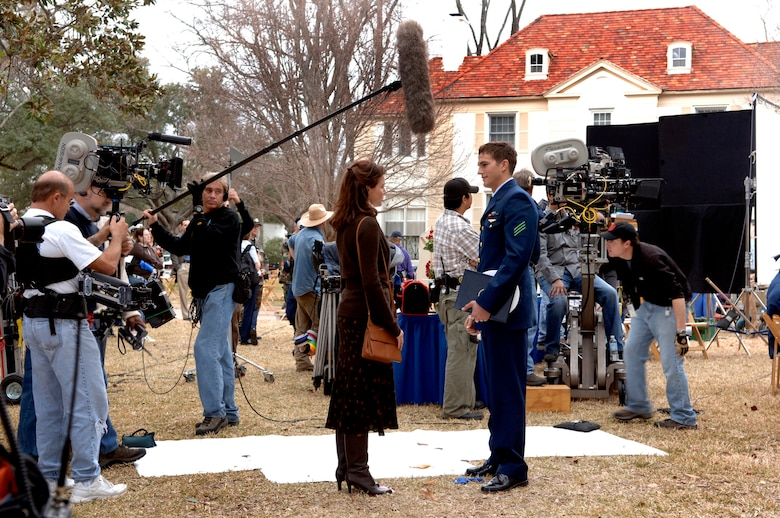 "BARKSDALE AIR FORCE BASE, La. (AFPN) -- Ashton Kutcher and Shelby Fenner films a scene from the movie ""The Guardian."" Parts of the movie were filmed on base Jan. 12 and 13. (U.S. Air Force photo by Master Sgt. Michael Kaplan)"