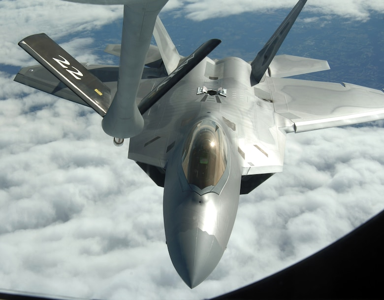 OVER THE UNITED STATES (AFPN) -- An F-22A Raptor from Langley Air Force Base, Va., refuels with a KC-135 Stratotanker from McConnell AFB, Kan., during the Raptor's first operational mission Jan. 21. The mission was flown in support of Operation Noble Eagle. The KC-135 was flown by the 18th Air Refueling Squadron. The F-22A was with the 27th Fighter Squadron. (U.S. Air Force photo by Master Sgt. Maurice Hessel)