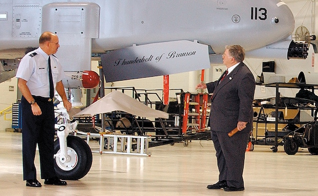 "WHITEMAN AIR FORCE BASE, Mo. -- Col. Mark Ronco, Air Force reservist and vice commander of the 442nd Fighter Wing, along with Branson Mayor Louis Schaefer, unveil the ""Thunderbolt of Branson"" at a ceremony Jan. 8 in the 442nd FW's 5-Bay maintenance hangar here.  Colonel Ronco said the dedication was in recognition of the City of Branson's support of the Air Force, veterans and the 442nd Fighter Wing.  The wing has 13 of its 15 A-10 Thunderbolt II aircraft dedicated to cities in Missouri.  (Photo by Master Sgt. William Huntington)"
