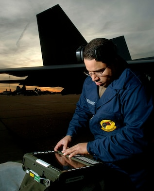 LANGLEY AIR FORCE BASE, Va. (AFPN) -- Staff Sgt. Ramon Rosaramos checks the weapons load status on a portable maintenance adapter in preparation for the F-22A Raptor's first real-world Operation Noble Eagle mission. Sergeant Rosaramos is a weapons loader from the 27th Aircraft Maintenance Squadron. (U.S. Air Force photo by Tech. Sgt. Ben Bloker)