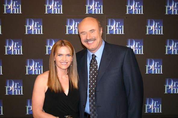 Kristine Bailey poses with Phillip C. McGraw, better known as Dr. Phil, after appearing on his show, which featured guests who had succeeded in losing weight.  (Courtesy photo of Peteski Prod. Inc. and CBS Paramount Domestic TV -- Mathew Imaging)