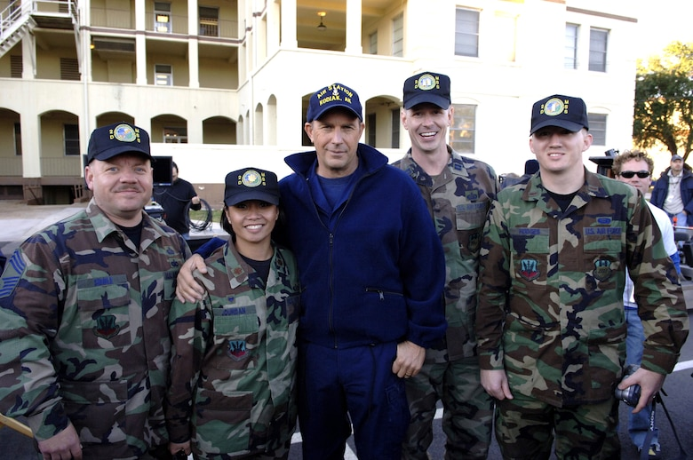 "BARKSDALE AIR FORCE BASE, La. (AFPN) -- Kevin Costner poses with Maj. Rose Jourdan, commander of the 2nd Mission Support Squadron, and her staff during a break in filming the movie ""The Guardian."" Parts of the movie were filmed on base Jan. 12 and 13.  (U.S. Air Force photo by Master Sgt. Michael Kaplan)"