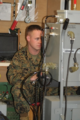 Sgt. John Fury, Explosive Ordnance Disposal technician Headquarters and Headquarters Squadron, views the monitor used to control the Remotec Andros robot, which EOD uses to investigate potentially threatening ordnance at the EOD building.