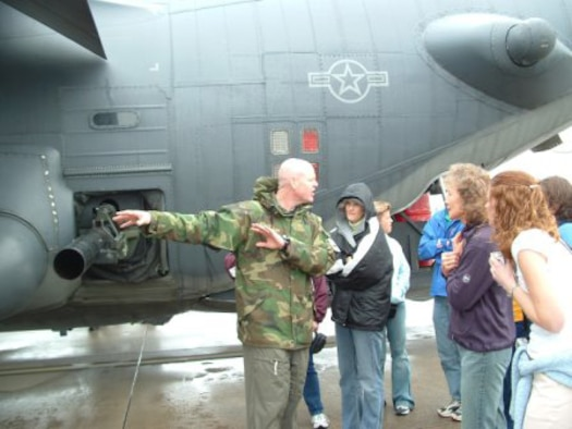 Lt. Col. Ted Fordyce, 16th Special Operations Squadron director of operations, explains the capabilites of the AC-130H Spectre Gunship to the teachers.