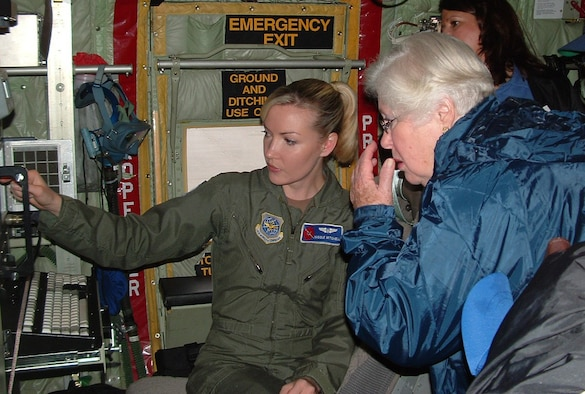1st. Lt. Nicole Mitchell, 403rd Wing, shows local teachers WC-130J weather tracking equipment, (U.S. Air Force photo by Amy Oliver)