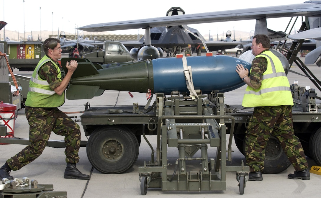 NELLIS AIR FORCE BASE, Nev. (AFPN) -- Royal Air Force Sgt. John Longstaff (left) and Senior Aircraftsman Philip Martin load an inert 1,000-pound bomb on a British Tornado jet Jan. 25 during Red Flag 06-1 here Jan. 21 to Feb. 18. Red Flag tests fliers' war-fighting skills in realistic combat situations. Flights involve more than 80 aircraft, including B-2 Spirit bombers and F-16 Fighting Falcons. The aircraft will fly missions day and night at the nearby Nevada Test and Training Range.  Along with the Air Force, units from the Army, Navy, Marine Corps, United Kingdom and Australia are participating. (U.S. Air Force photo by Master Sgt. Kevin J. Gruenwald)