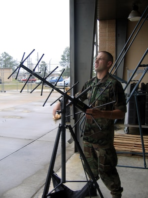 MOODY AIR FORCE BASE, Ga. - Senior Airman Cody Mass, 347th Communications Squadron ground radio technician, sets up a satellite communication device. Airman Mass is the only Air Force Special Operations Command selection for the Scholarship for Outstanding Airman program. The program provides Airman Mass  $15,000 per year to enroll in college and return to the Air Force after graduation as a second lieutenant. (Photo by Airman Eric Schloeffel)