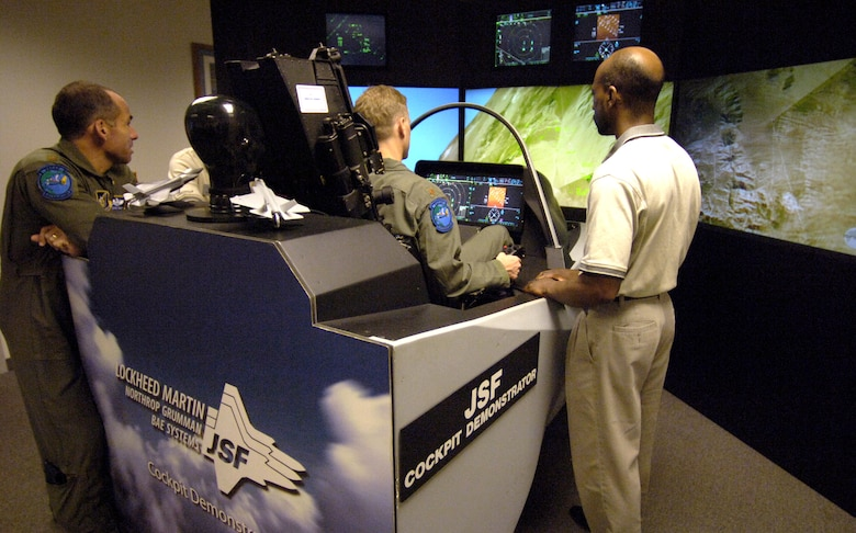 HICKAM AIR FORCE BASE, Hawaii (AFPN) -- Maj. Don Borchelt flies the F-35 Joint Strike Fighter aircraft simulator here. The simulator demonstrates the advanced capabilities of the F-35 -- the joint fighter of the 21st century. Major Borchelt is from the Headquarters Pacific Air Force advanced programs office. (U.S. Air Force photo by Tech. Sgt. Shane A. Cuomo)