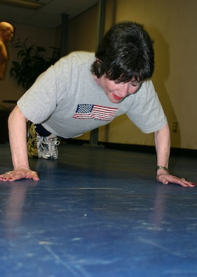 TINKER AIR FORCE BASE, Okla. (AFMCNS) - Bunny Greenroyd, 552nd Communications Group commander's secretary, performs an Air Force push-up.  A little less than a year ago the 58-year-old Greenroyd could only do one or two.  Now she can do 100. (Air Force photo by Staff Sgt. Stacy Fowler)