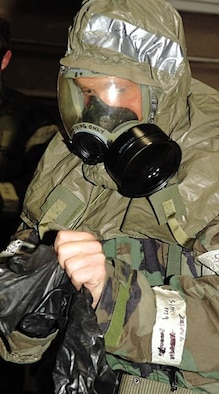 Senior Airman Keith Stetser, 28th Communications Squadron, 28th Bomb Wing, Ellsworth Air Force Base, S.D., processes through the Contamination Control Area 6 Nov 05. SrA Stetser is participating in Ellsworth's Badlands Express 06-01 Operational Readiness Exercise. (US Air Force Photo By: AirmanErica M. Stratton)(RELEASED)