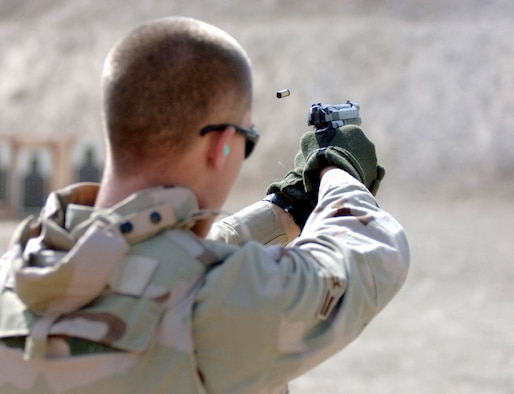 Airman 1st Class Brandon Newton fires an M-9 Beretta at a match at Victory Base Complex, Iraq, on Monday, July 3. Nine teams from Sather Air Base and Iraqi New Al Muthana Air Base competed, testing their endurance, skill and marksmanship. The four-person teams were made up of deployed Airmen from various career fields. Airman Newton is assigned to the 447th Air Expeditionary Group, and is deployed from the 96th Services Squadron at Eglin Air Force Base, Fla. (U.S. Air Force photo/Staff Sgt. Bryan Bouchard)