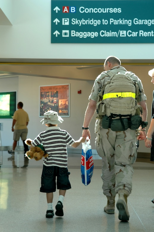 Sergeant Rumler and his son head for baggage claim before heading home. They were among 12 security forces Airmen returning Saturday. The group was greeted by family, squadron members and the 92nd Mission Support Group commander, Col. Van Fuller, the 92nd Security Forces Squadron commander, Maj. Philip Holmes, and first sergeant, Master Sgt. John Bell.