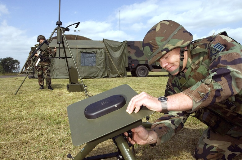 Staff Sgt. Craig Gaillardet attaches the lightning detector to the weather station at Wiesbaden Army Airfield, Germany, June 21. Sergeant Gaillardet, a Pecos, Texas, native, is a combat weather forecaster with the 7th Weather Squadron headquartered in Heidelberg, Germany. (U.S. Air Force photo/Master Sgt. John E. Lasky)