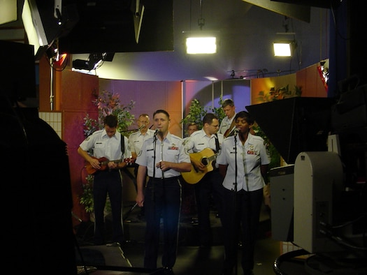HONOLULU, Hawaii -- Members of the Pacific Air Forces Band, Hana Hou (Hawaiin for One More Time) perform patriotic music  July 4th on Honolulu TV station KHNL, the local  NBC affiliate.  The band performed during three separate live segments on  KHNL's morning program and talked with morning host, Marvin Buenconsejo, about the importance of the band to the morale and readiness of Airmen, the total force nature of our military and the shows they performed on Independence Day to include two performances at Hickam Harbor.  (U. S. Air Force photo by CMSgt Sharon Johnson)